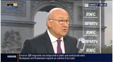 Michel Sapin face à Jean-Jacques Bourdin en direct